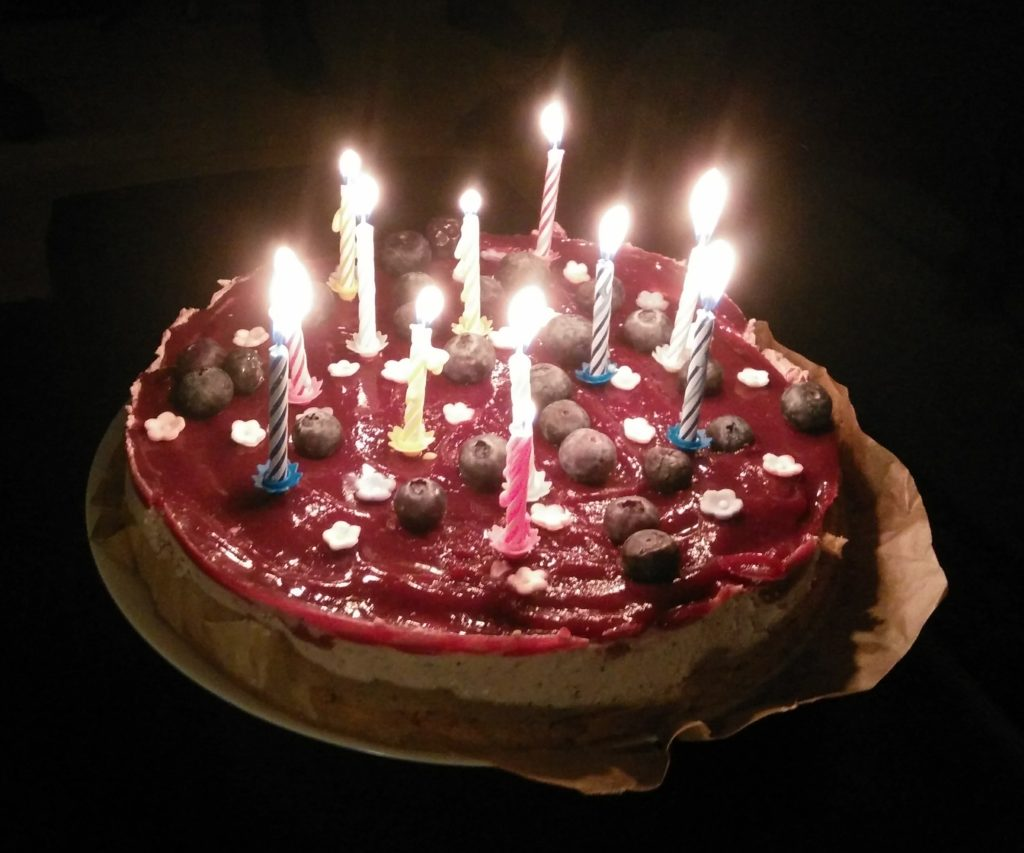 No bake blueberry cheesecake with lighted birthday candles